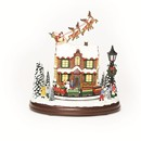 Santa With Sleigh Over House With Train (musical)